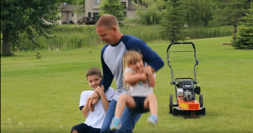 Subaru engine powered brush cutter with dad playing with kids